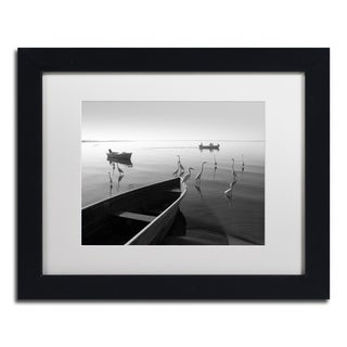 Moises Levy 'Herons and 3 Boats' White Matte, Black Framed Canvas Wall Art