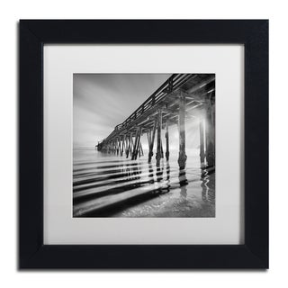 Moises Levy 'Pier and Shadows' White Matte, Black Framed Canvas Wall Art