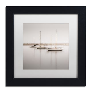 Moises Levy 'Three Boats' White Matte, Black Framed Canvas Wall Art