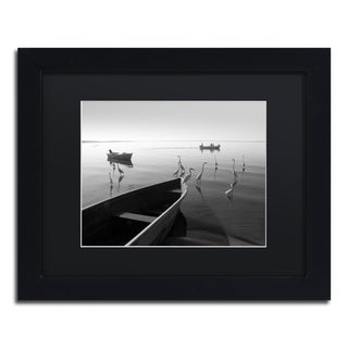 Moises Levy 'Herons and 3 Boats' Black Matte, Black Framed Canvas Wall Art