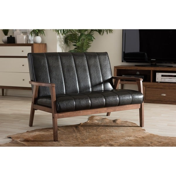 baxton studio nikko mid century modern scandinavian style black faux leather wooden 2 seater black leather mid century