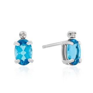 1 TGW Oval Blue Topaz and Diamond Earrings in 14k White Gold