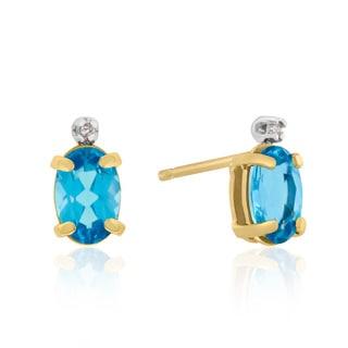 1 TGW Oval Blue Topaz and Diamond Earrings in 14k Yellow Gold