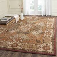 Safavieh Handmade Heritage Timeless Traditional Rust/ Ivory Wool Rug - 6' x 9'