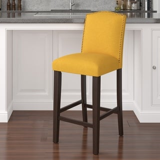 Skyline Furniture Nail Button Arched Barstool in French Yellow Linen