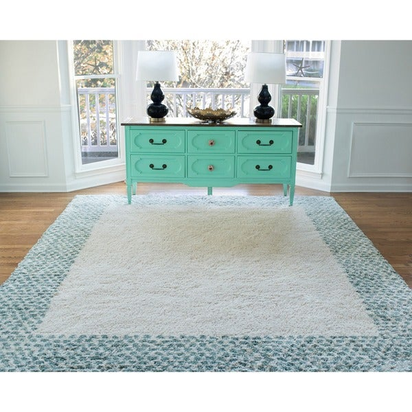 Mohawk Home Spotted Border Woven Area Rug. Opens flyout.