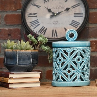 Ceramic Gloss Finish Cyan Small Round Canister with Ring Handle and Cutout Cross Design