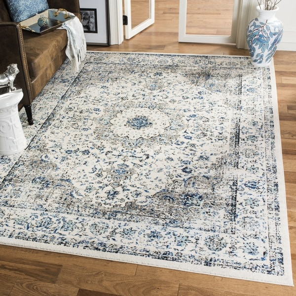 Safavieh evoke vintage oriental grey ivory distressed for Blue and white oriental rug