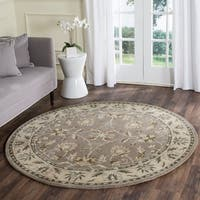 Safavieh Handmade Heritage Timeless Traditional Grey/ Beige Wool Rug - 6' Round