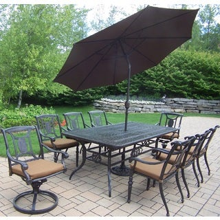 Willoughby 11-piece Dining Set, with Extendable Table, Sunbrella Cushioned Swivel Rockers, Chairs, and Umbrella with Stand