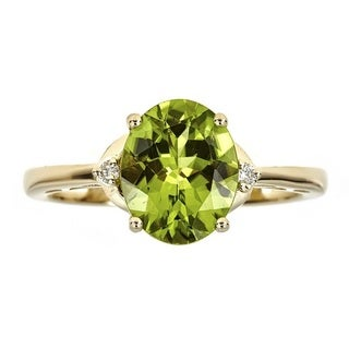 Anika and August 10k Yellow Gold Oval Peridot and Diamond Accent Ring