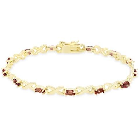 Dolce Giavonna Gold Over Sterling Silver Oval Cut Gemstone XO Link Bracelet