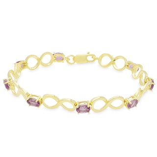 Dolce Giavonna Gold Over Sterling Silver Oval Gemstone Infinity Design Bracelet