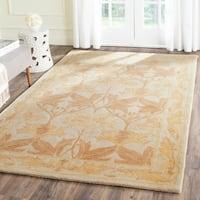 Safavieh Handmade Antiquity Beige/ Gold Wool Rug - 4' x 6'