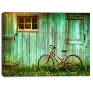 Designart - Old Bicycle against Barn - Landscape Photo Canvas Art Print