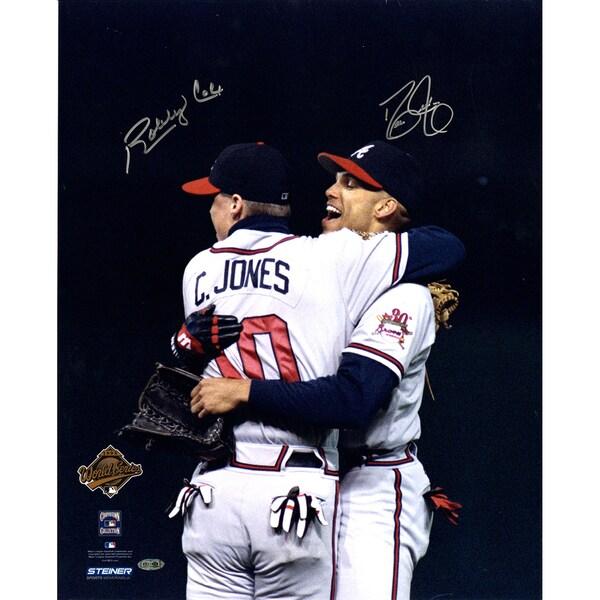 David Justice/Bobby Cox Dual Signed Hugging Chipper Jones 16x20 Photo