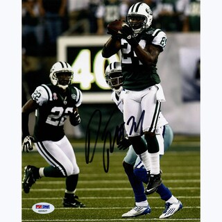 Darrelle Revis Signed Intercepting Football vs. Cowboys 8x10 Photo (Signed in Black) 8x10 Photo ( PSA/DNA Auth)