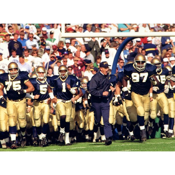 Lou Holtz Running onto the Field with Taylor, Mayes, and Young 8x10 Photo uns.