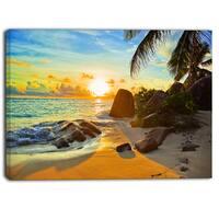 Designart - Sunset in Tropical Beach - Landscape Photo Canvas Print - Orange