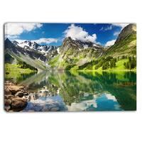 Designart - Reflecting Mountain Lake - Landscape Canvas Artwork - Green