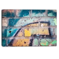 Designart - Old Brick Graffiti - Street Art Canvas Print