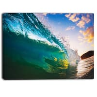 Designart - Ocean Wave at Sunset - Photography Canvas Print