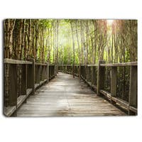 Designart - Wooden Bridge in Forest - Landscape Photography Canvas Print - Brown