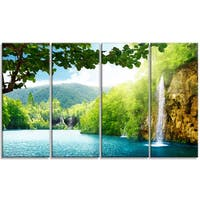 Designart - Waterfall in Deep Forest - 4 Panels Landscape Photography Canvas Print - Blue