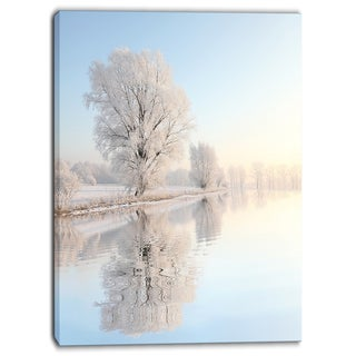 Designart - Frosty Winter Tree by Rising Photo Canvas Art Print - Blue