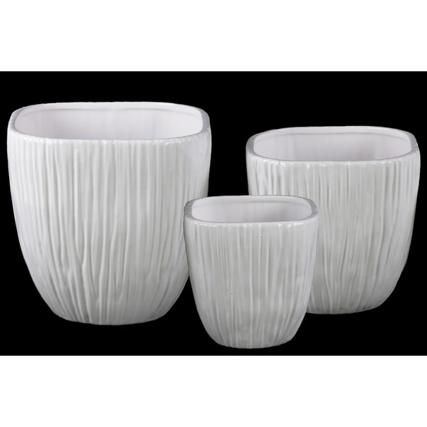 Shop coated finish white ceramic round flower pot with wave pattern coated finish white ceramic round flower pot with wave pattern mouth and ribbed side set mightylinksfo