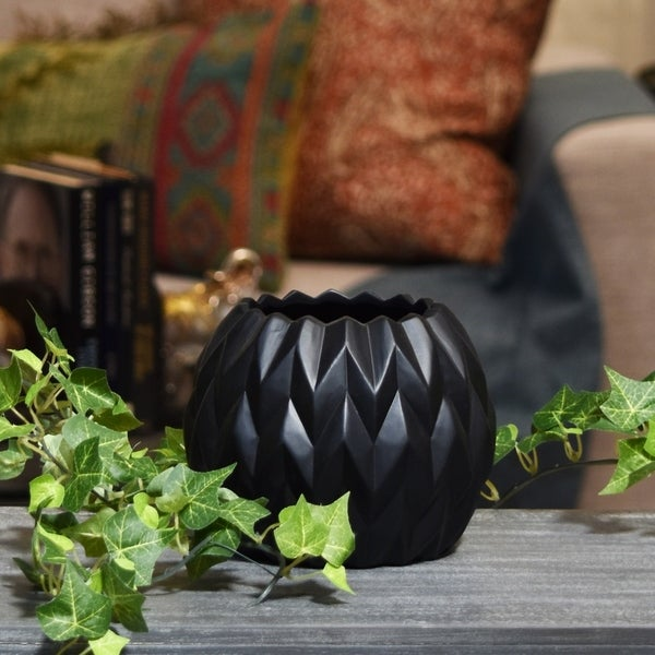 UTC21434: Ceramic Round Low Vase with Uneven Lip and Embossed Wave Design SM Matte Finish Black