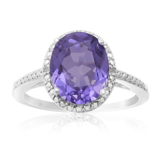 3 TGW Oval Shape Created Tanzanite and Diamond Halo Ring In Sterling Silver