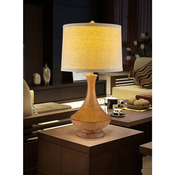 30.5-inch tall resin table lamp.