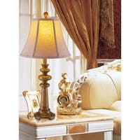 26-inch Tall resin table lamp.