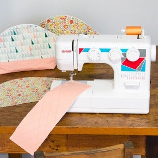 Janome MOD-19 Easy-to-Use Sewing Machine with 19 Stitches, Automatic Needle Threader, and 5-piece Feed Dogs