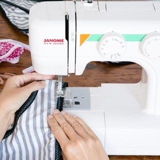 Janome MOD-15 Easy-to-Use Sewing Machine with 15 Stitches, Adjustable Stitch Length, and 5-piece Feed Dogs