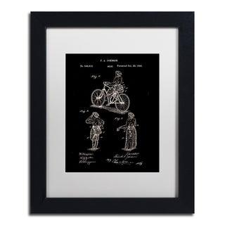 Claire Doherty 'Cycling Skirt Patent 1885 Black' Matted Framed Art
