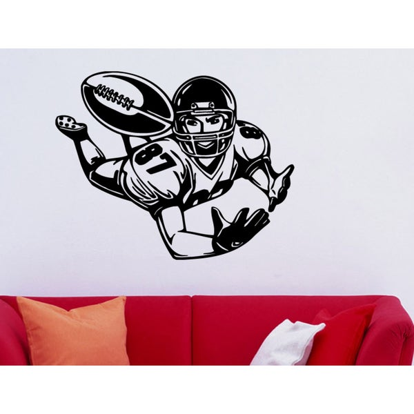 Football player catches a ball Wall Art Sticker Decal