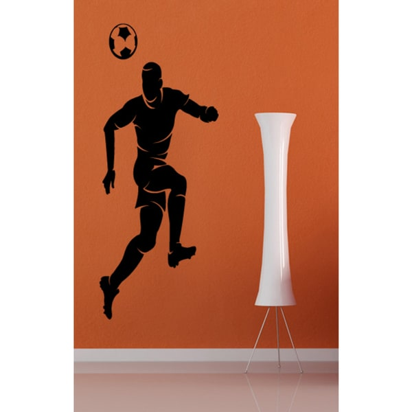 Soccer player hits the ball head Wall Art Sticker Decal