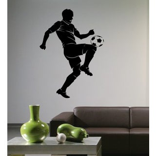 Soccer player hits the ball with his knee Wall Art Sticker Decal