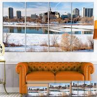 Designart 'City of Saskatoon Winter Panoramic' Landscape Canvas Art Print - Blue