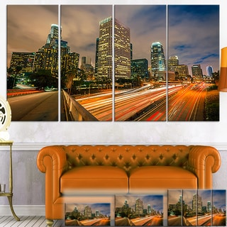 Designart 'Los Angeles Yellow Skyline Night' Cityscape Canvas Print