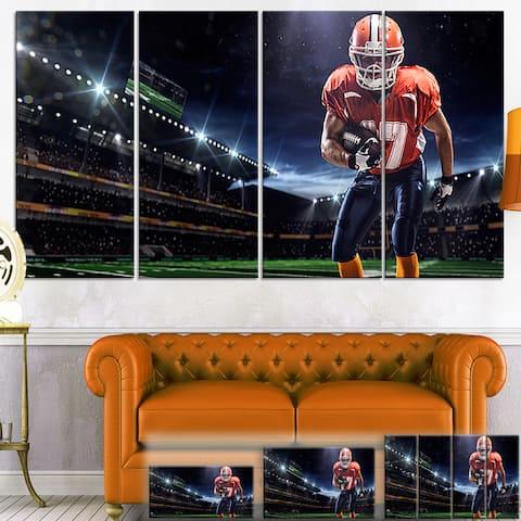 Designart 'American Footballer in Action on Stadium' Sports Canvas Print