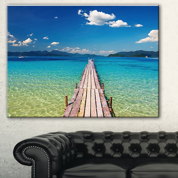 Designart 'Wooden Pier in Tropical Paradise' Seascape Photo Canvas Print