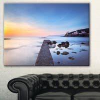 Designart 'Castiglioncello Bay Concrete Pier' Seascape Photo Canvas Print