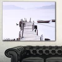 Designart 'Foggy Sea with Pier and Boats' Seascape Photo Canvas Print
