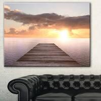 Designart 'Yellow Sea and Brown Pier' Seascape Photo Canvas Print