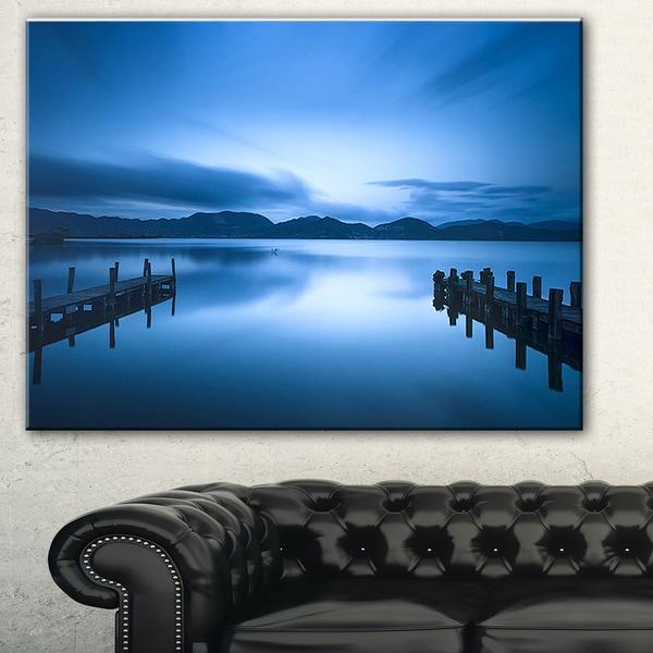 Designart 'Dark Blue Sea and Piers' Seascape Photo Canvas Print
