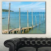 Designart 'Wooden Piers by Blue Sea' Seascape Photo Canvas Print