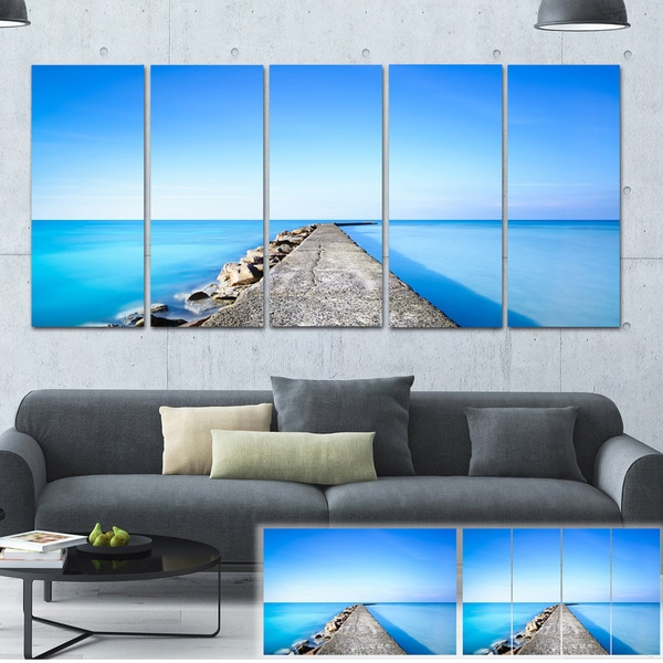 Designart 'Concrete and Rocks Pier' Seascape Photo Canvas Print